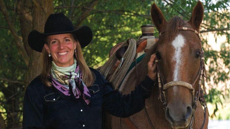 liza jane nichols standing with horse