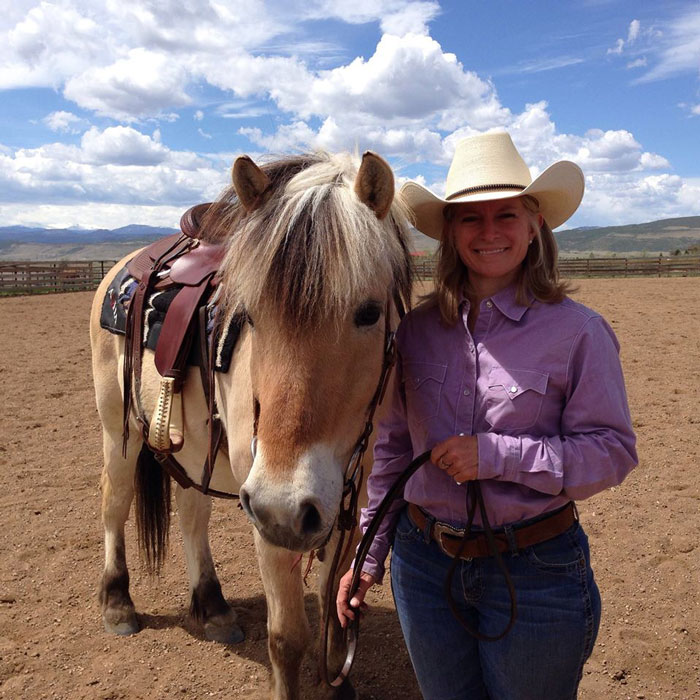 Freddie the Norwegian Fjord Horse and Christine Hamilton, Western Horseman editor, at a clinic with Buster and Sheryl McLaury.