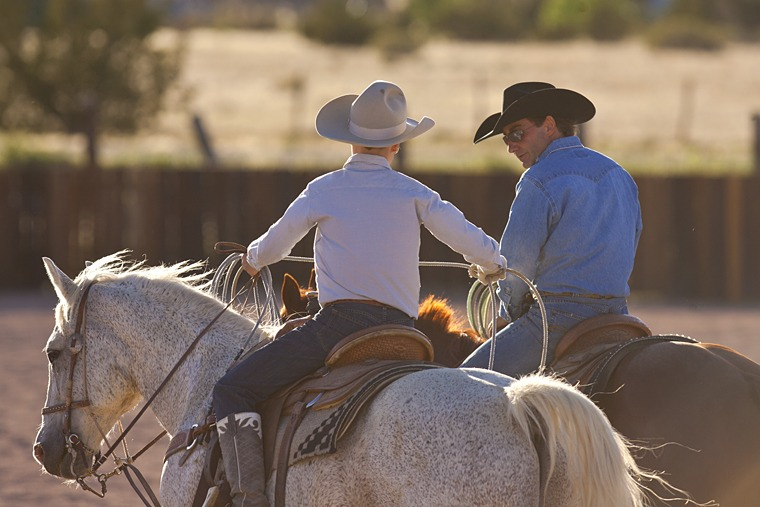 Mortenson and his son, Wyatt, work together on their team roping skills.