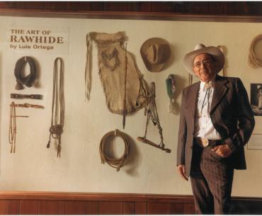 Luis-in-front-of-rawhide-display web