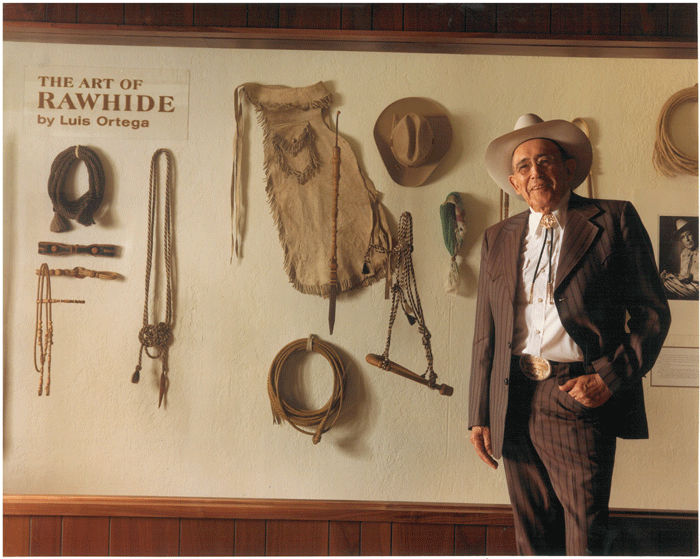 Luis-in-front-of-rawhide-display web
