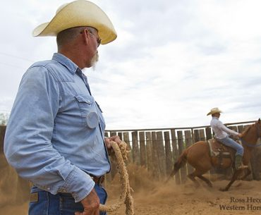 Rod Smith watches assistant trainer Matt Hamm put an early ride on a young colt. For more than 25 years, Smith and Jeff Williams have partnered in a colt-starting business in Post, Texas. The two men continue to train young horses for area ranches and cowboys.