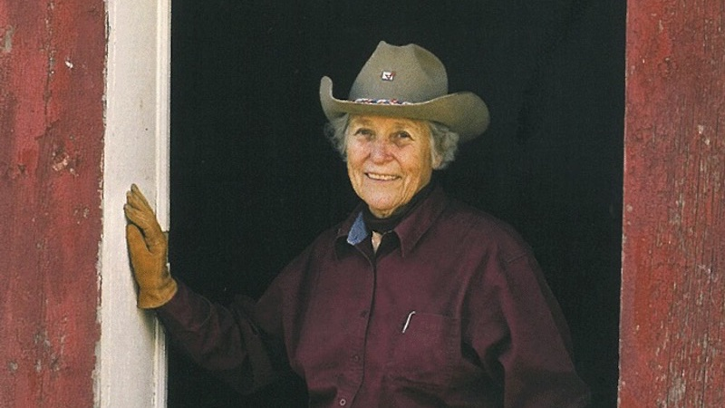 Linda Davis leaning in barn doorway