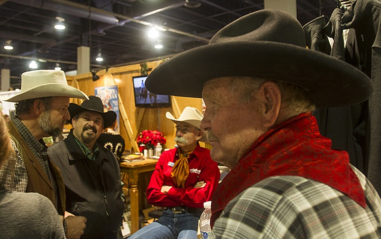 Cowboys visit the Western Horseman booth in the Las Vegas Convention Center.