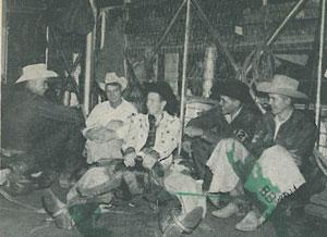 rodeo cowboys sitting around talking
