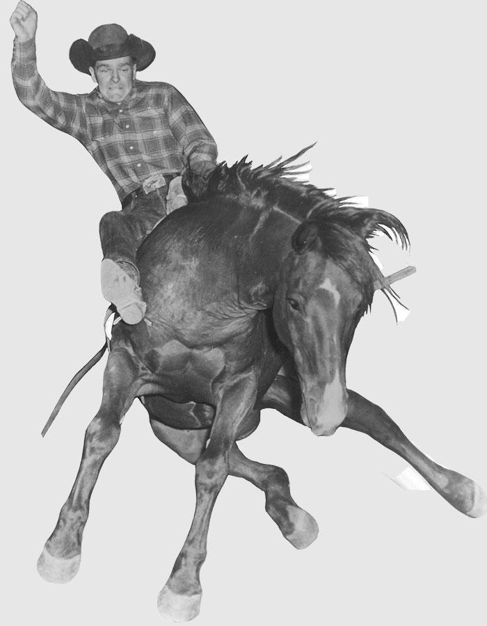 Casey Tibbs riding a bareback horse