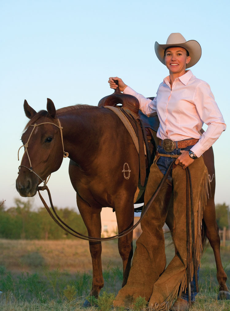 Heather Stiles standing by horse