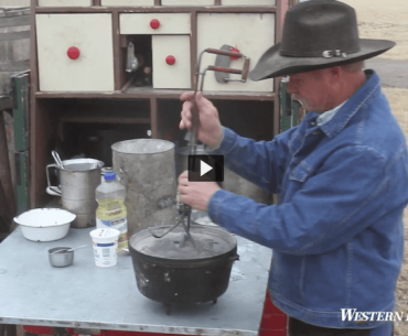 Kent Rollins opening a cast iron dutch oven