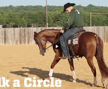 Ron Ralls riding a horse in a circle