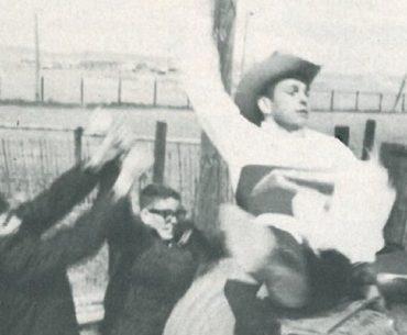 men practicing on a bucking barrel