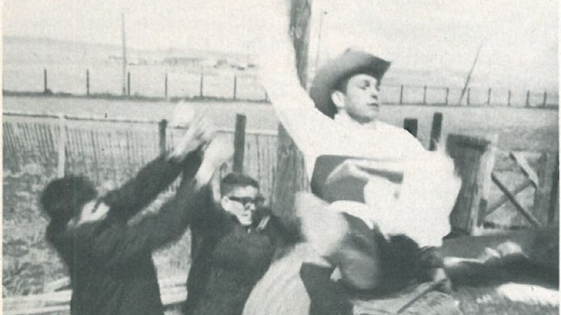 men practicing on a bucking barrel