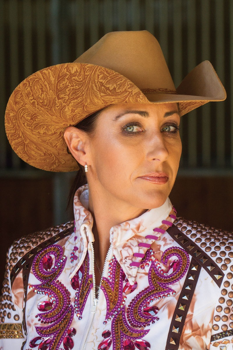 Reining competitor Tish Fappani wears a custom hat made by Shorty s Caboy  Hattery. The Arizona horsewoman likes to coordinate her hats to her show  outfits. b075b6d767f