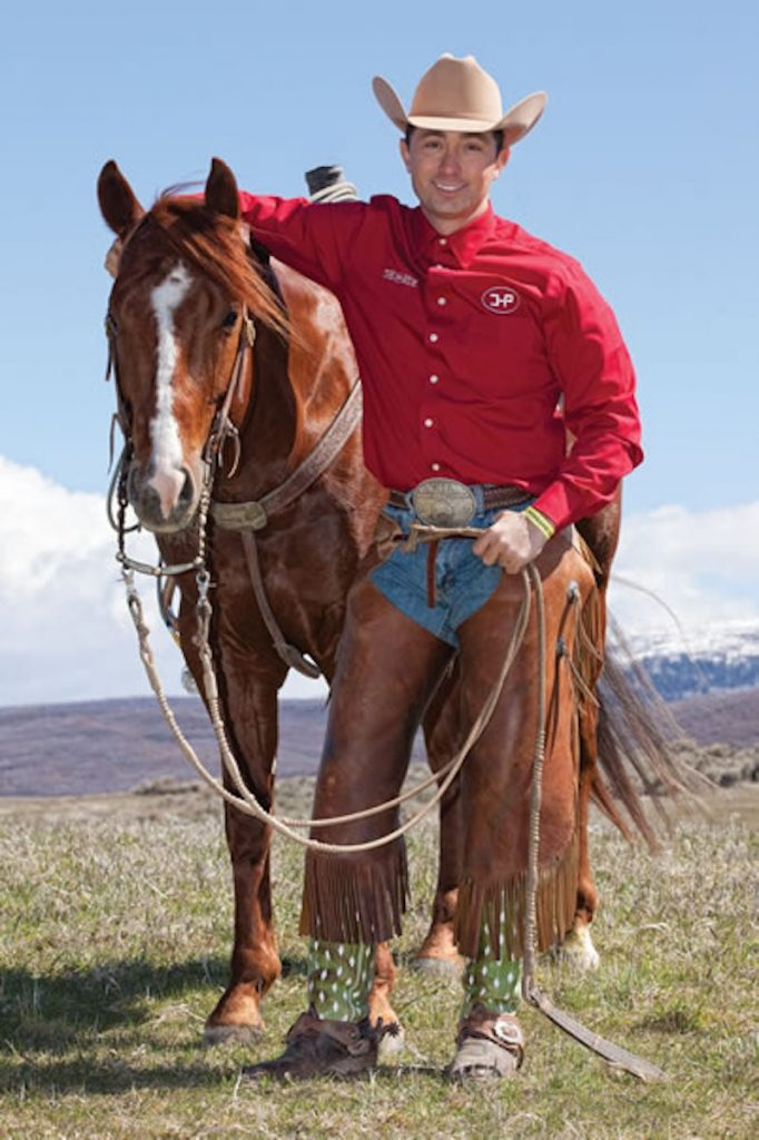 Aaron Ralston stands next to one of his horses.