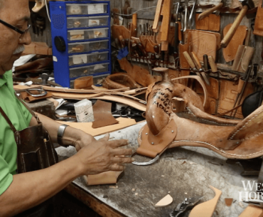 Robert Salas making a saddle