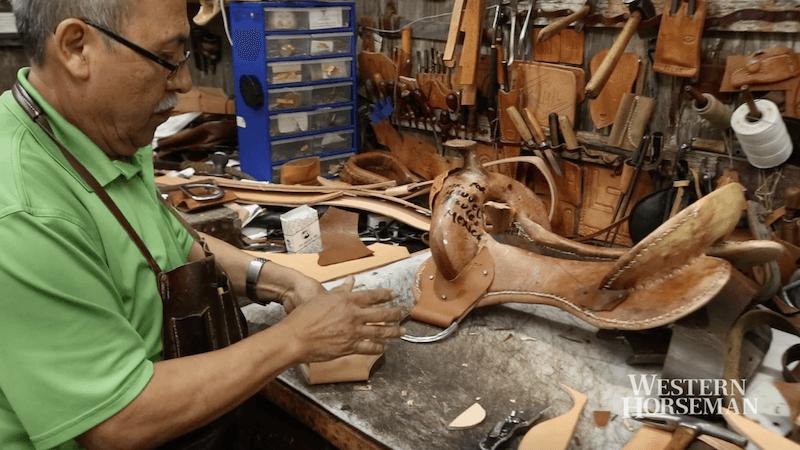 Robert Salas making a saddle