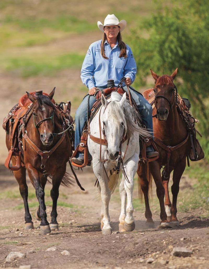 Lari Dee Guy leading horses