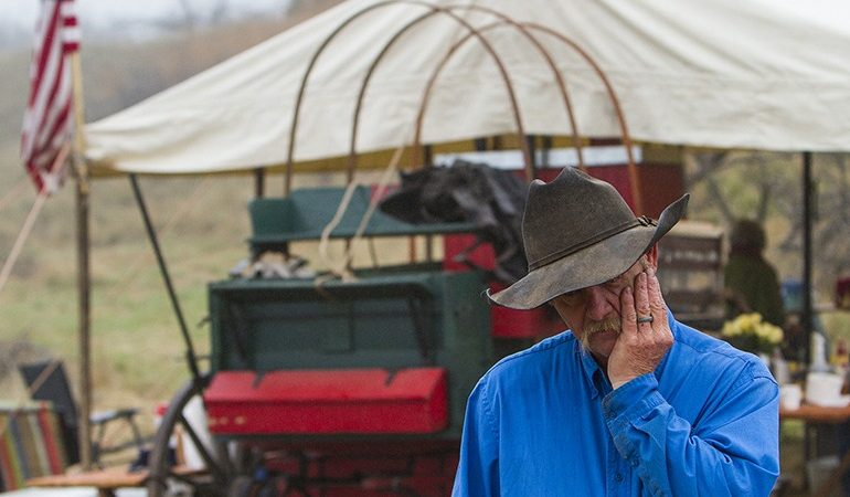 Kent Rollins in front of chuckwagon