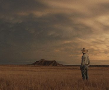 cowboy standing in the rider movie