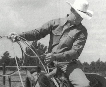 Clay O'Brien Cooper with a rope on a horse