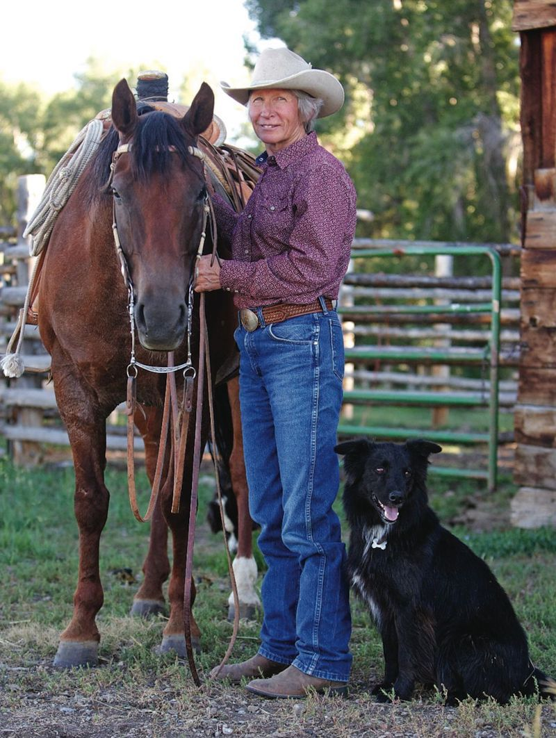 Dianne Boroff standing with horse and dog