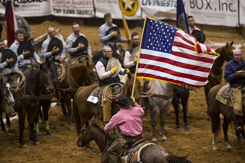 cowboy riding with American flag