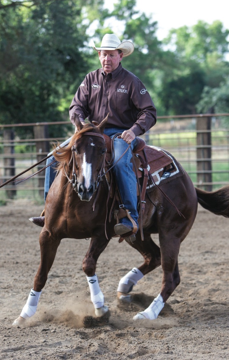 Ron Emmons turns horse by planting its back leg