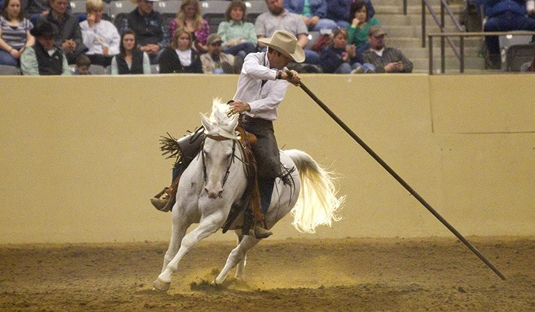 horseman Jonathan Field rides horse with garrocha pole