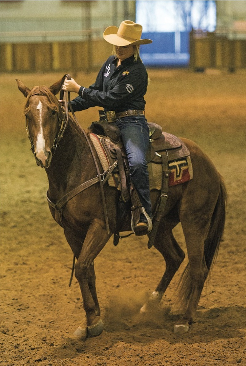 Ashley Adams demonstrates on horseback using only hands to pickup horse's shoulder