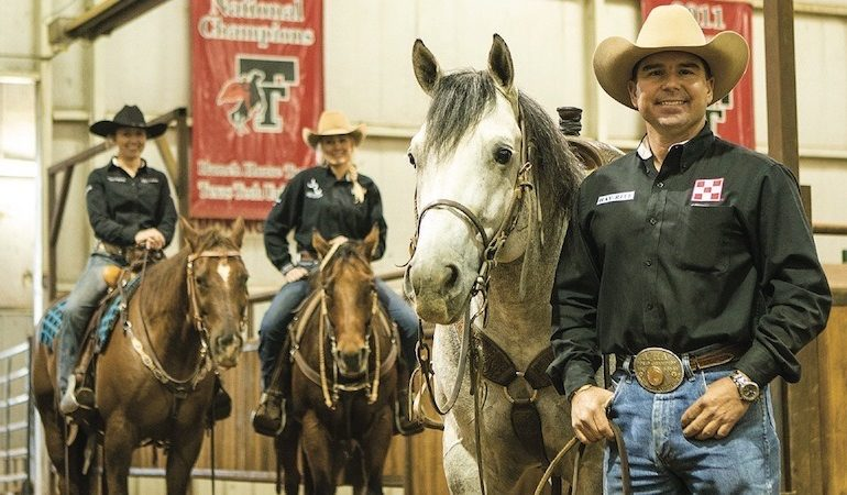 Texas Tech ranch horse trainer Chance O'Neal standing with horse and team members