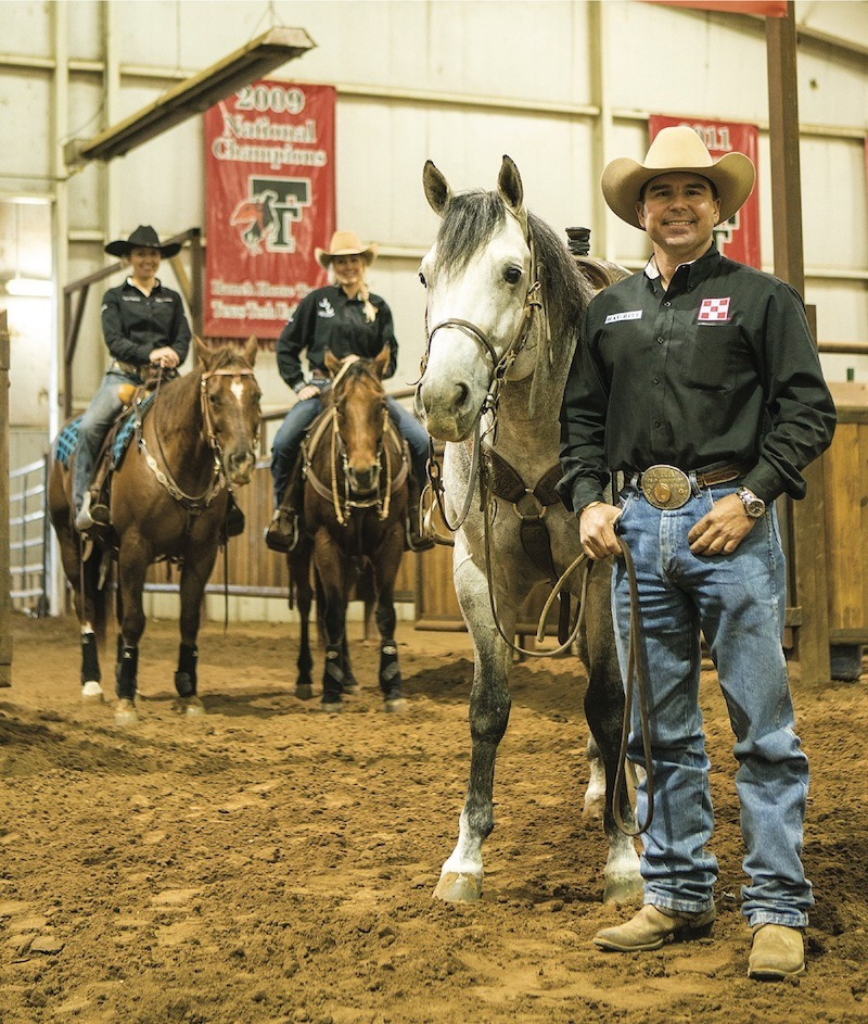 Chance O'Neal standing with Texas Tech ranch horse team members