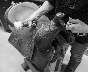 saddle maker stamping leather