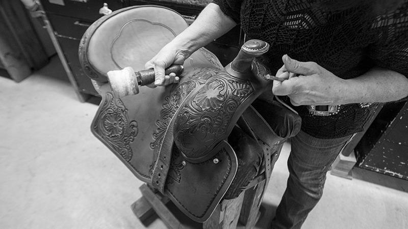 saddle maker stamping leather