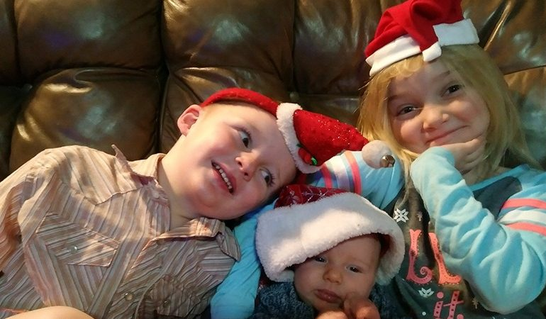 ranch kids wearing santa hats
