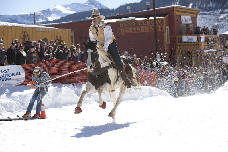 Jeff Dahl pulling skier in the skijoring