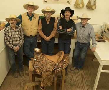 saddlemakers standing in front of Wade saddle