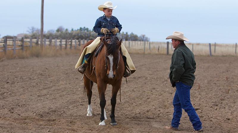 Ken McNabb instructing Jake Gillham on backing up a horse