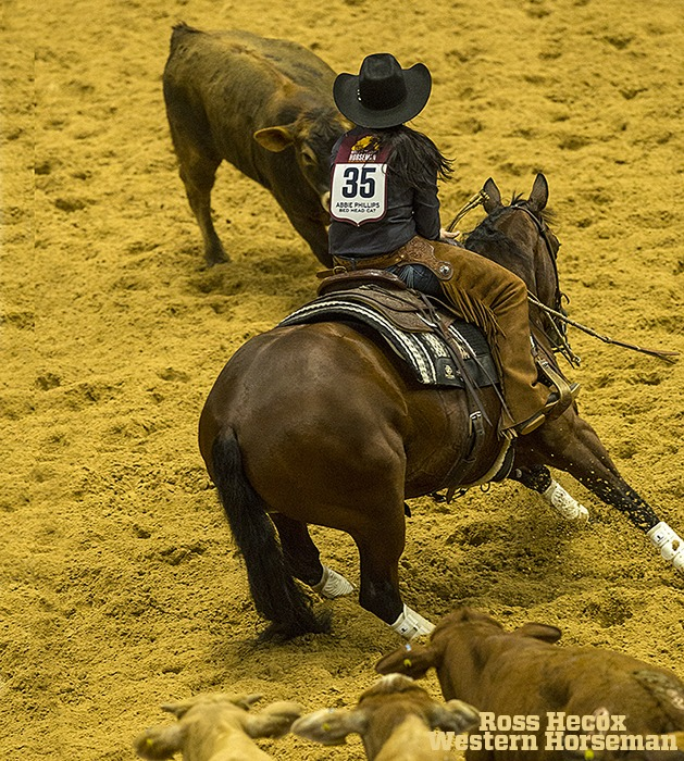 Abbie Phillips working a cow in the heard work at World's Greatest.