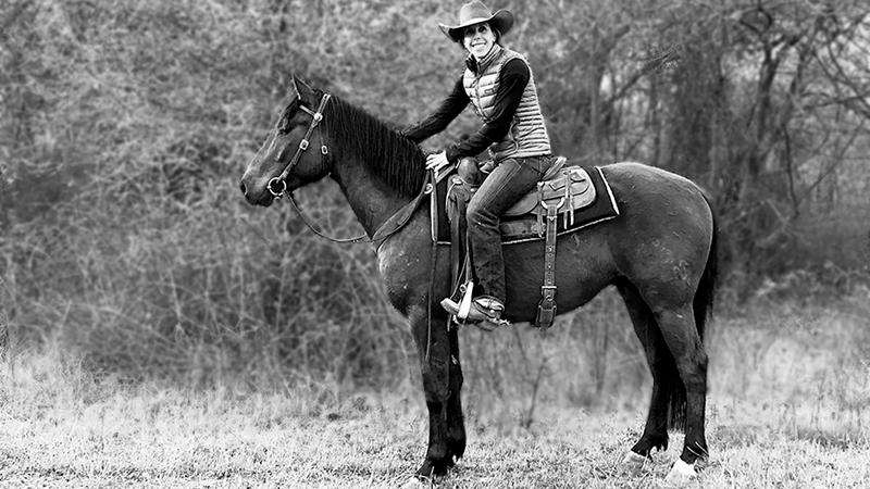 Kelli Neubert riding an Azteca horse