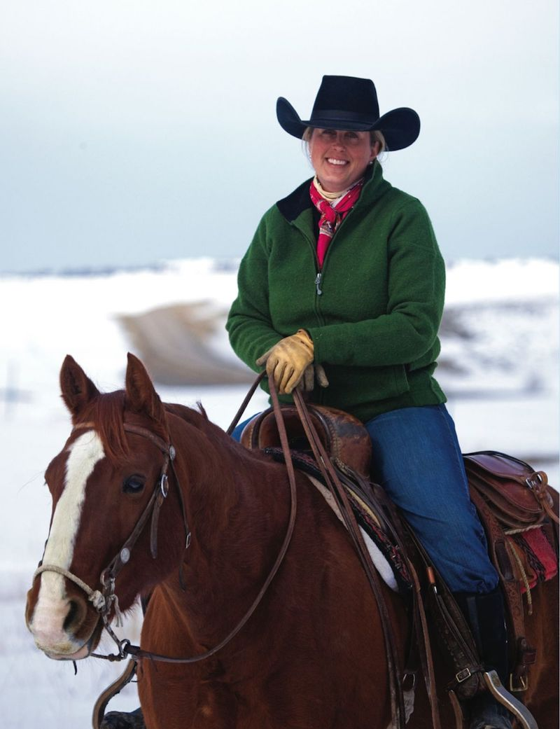 Monique Miller horseback in the snow.
