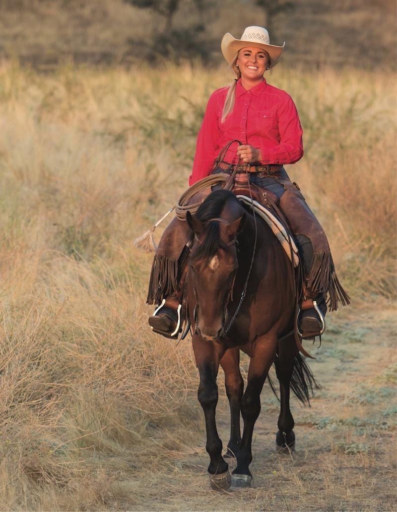 Nicole Courtney Smith riding a bay horse
