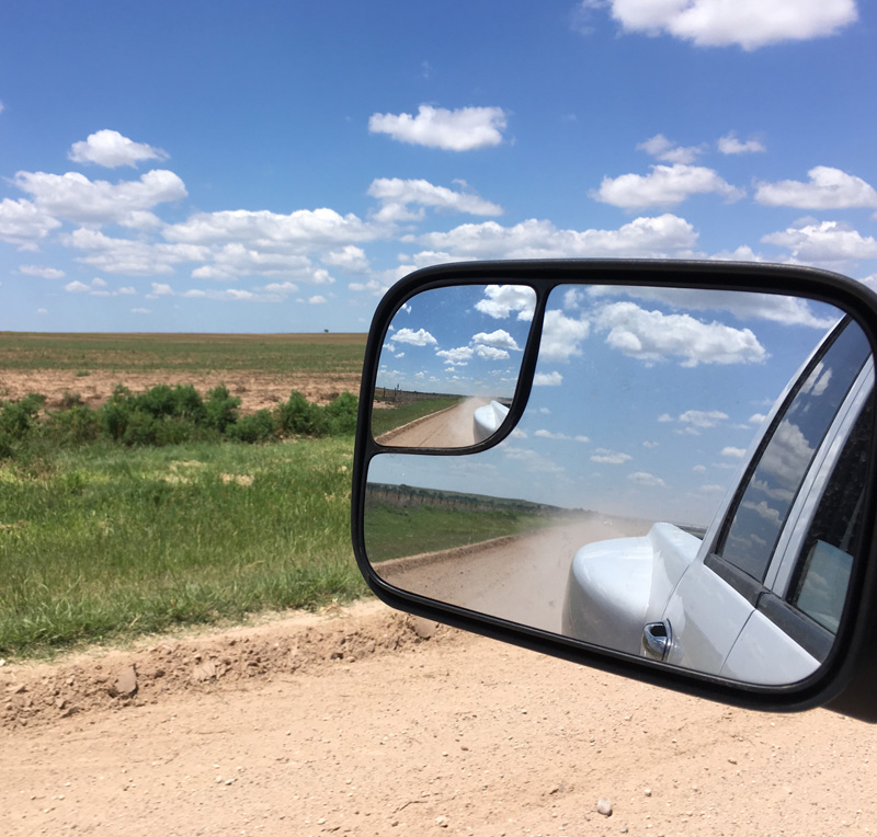 Western Horseman truck looking through side mirror
