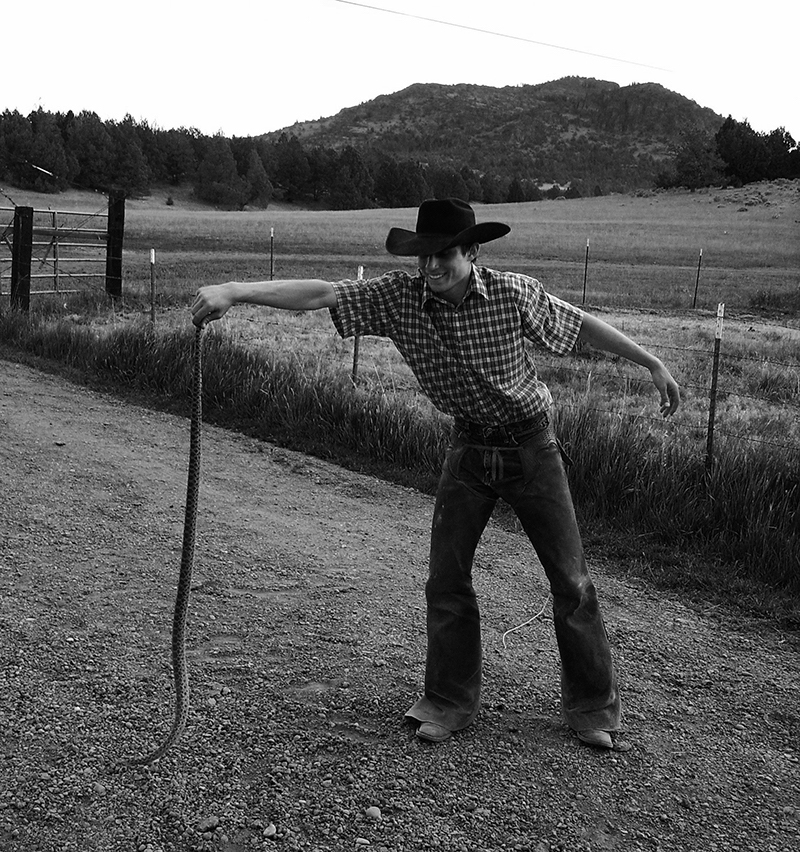 Cowboy holding snake