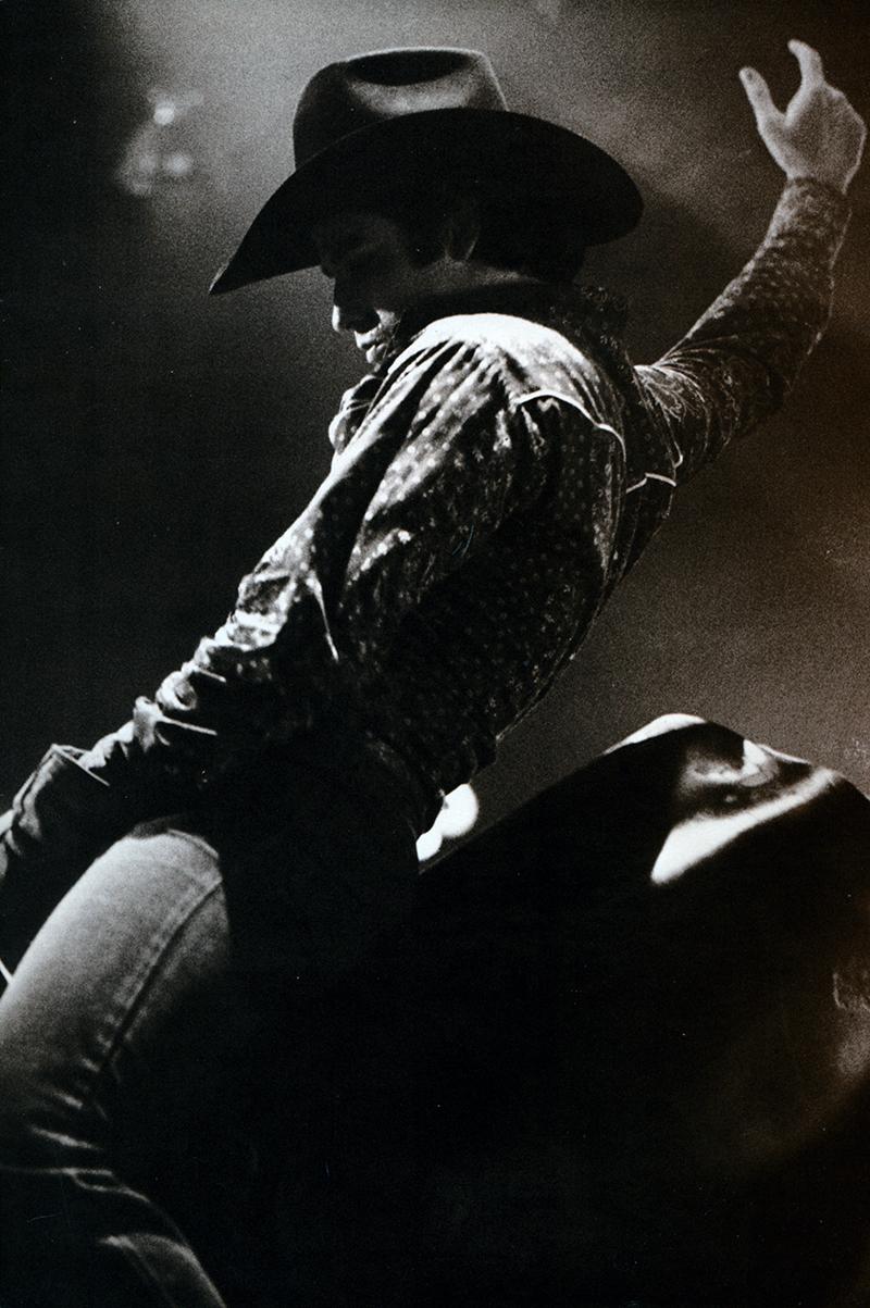 John Travolta riding a mechanical bull in the movie Urban Cowboy