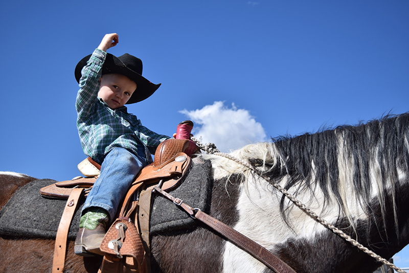 cowboy puts hand in the air
