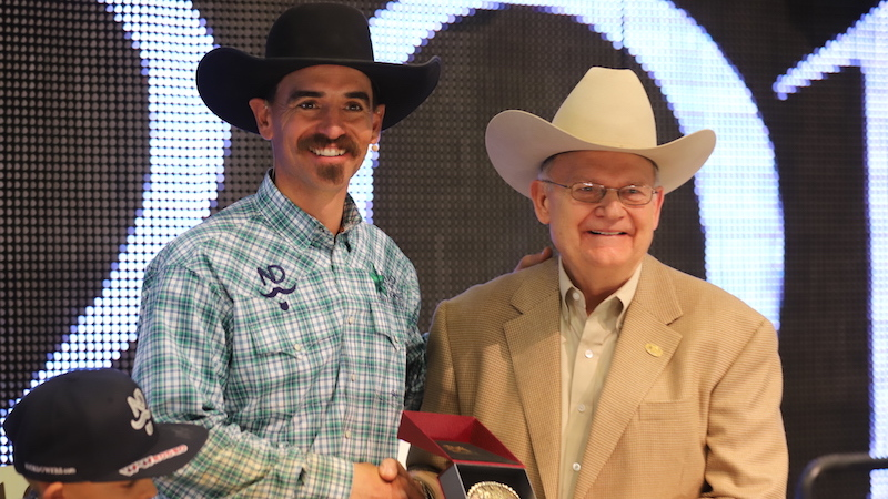 Nick Dowers accepting award from Dr. Glenn Blodgett at Road to the Horse 2019