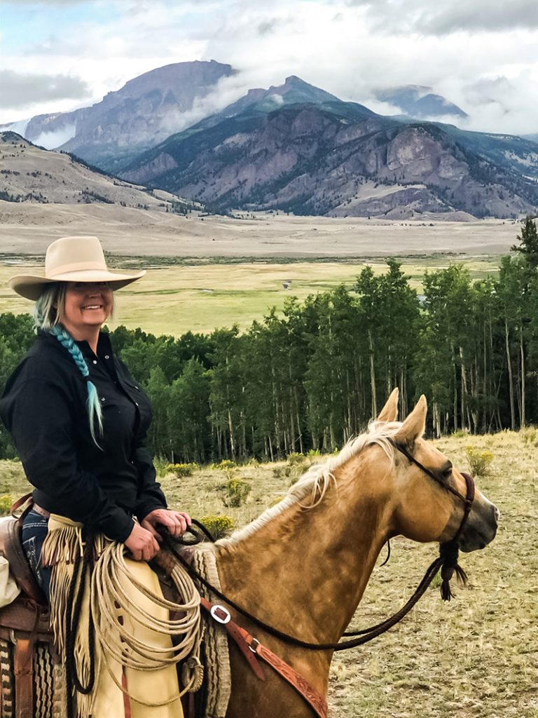 Nicole Grady sits on palomino horse