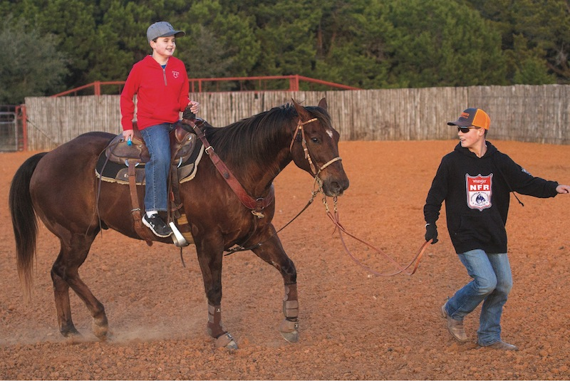 Jackson and Walker riding special team roping horse Bob