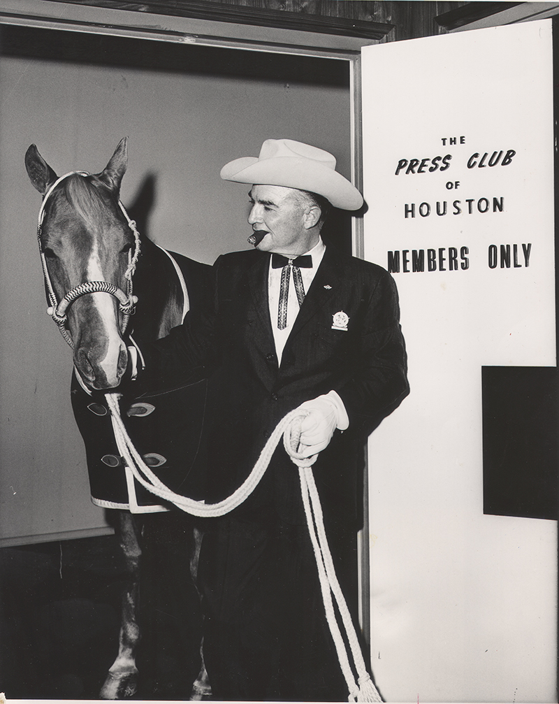 Rex Cauble holding Quarter Horse stallion Cutter Bill at The Press Room in Houston