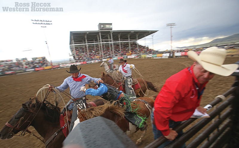 National High School Rodeo bronc rider and pick-up men