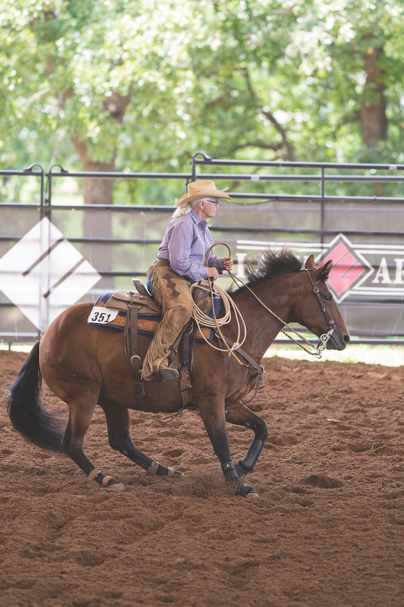 Marilyn Peters riding horse in arena